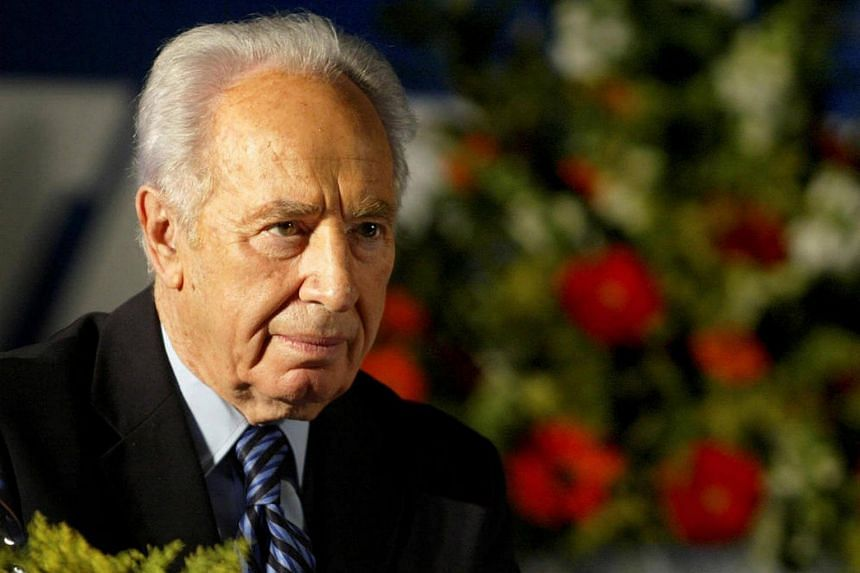 Former Israeli president Shimon Peres attends his party's conference in Tel Aviv, on Dec 12, 2004.