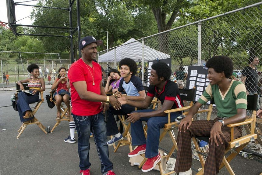 Grandmaster Flash (in red) on set with the cast of The Get Down, a Netflix drama series which is semibiographical.