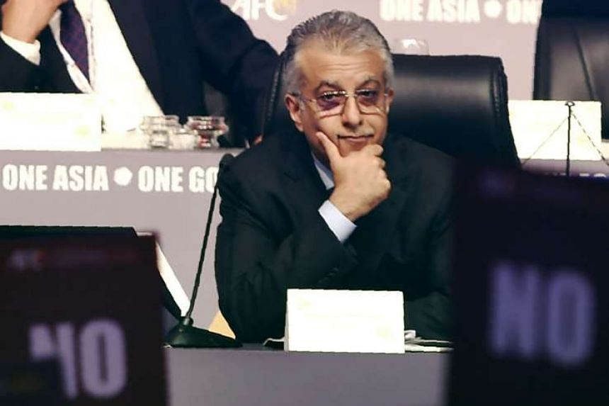 Asian Football Confederation president Sheikh Salman Ebrahim Al Khalifa looks on as members hold up 'No' voting cards during an AFC Extraordinary Congress in Goa. Football Association of Singapore president Zainudin Nordin was the only delegate who voted