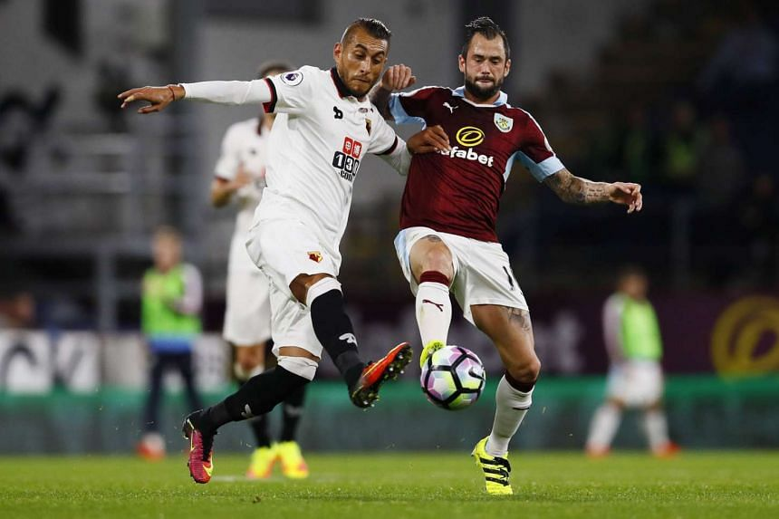 Watford midfielder Roberto Pereyra (left) challenging Burnley's Steven Defour for the ball during a Premier League match on Monday. Belgium international Defour led his side to a 2-0 victory with two assists.