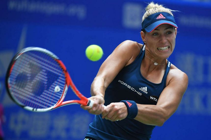 Angelique Kerber hitting a backhand during her second round match against Kristina Mladenovic of France at the Wuhan Open. The top-ranked German let two set points slip in the first set but bounced back to earn a meeting with Petra Kvitova today.