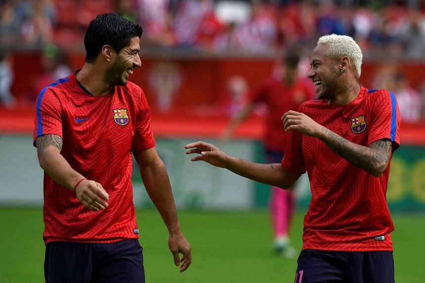 Barcelona's artillery remains well-stocked in Lionel Messi's absence - with Luis Suarez (left) and Neymar, twice, both on target in the La Liga win at Sporting Gijon.
