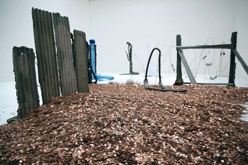 Michael Dean's mini mountain of bronze onepenny pieces is the political talking point of the Turner Prize exhibition.