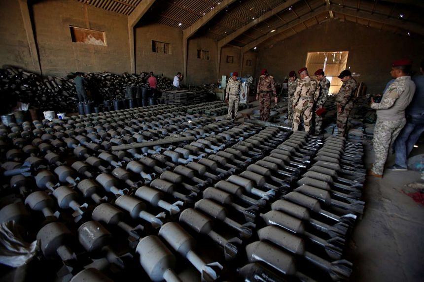 Weapons that belonged to ISIS militants are seen at an Iraqi army base on Sept 4, 2016.