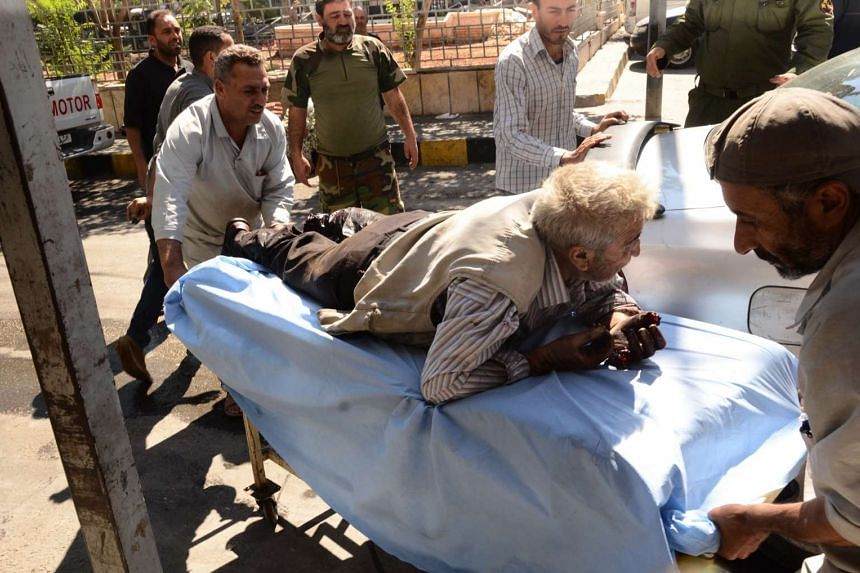 A wounded Syrian man is rushed into a hospital after he was hit by mortar shells targeting government-controlled Aleppo neighbourhoods on Sept 28, 2016.