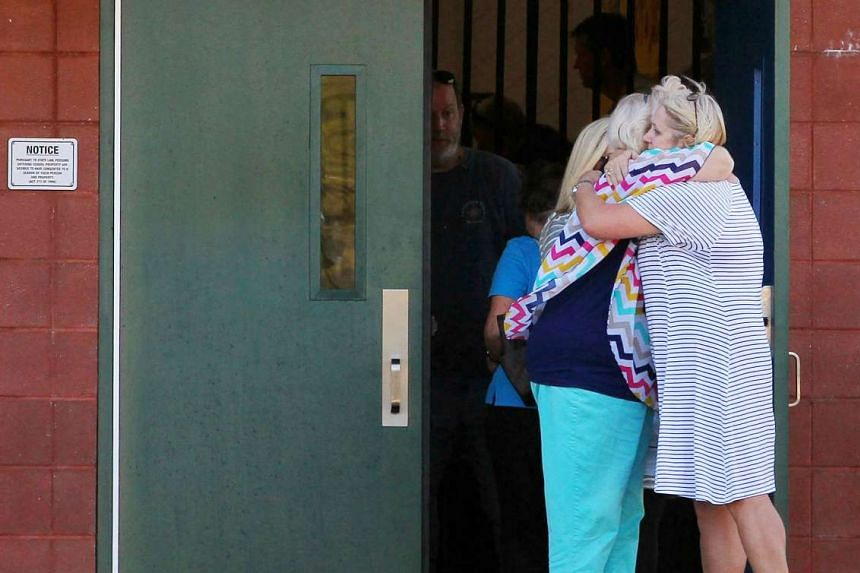 Two teachers hug outside of Townville Elementary School after a shooting in Townville, South Carolina.