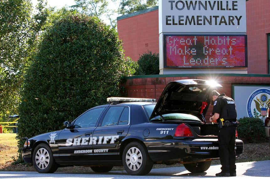 An Anderson County sheriff's deputy stands outside of Townville Elementary School after a shooting in Townville, South Carolina.
