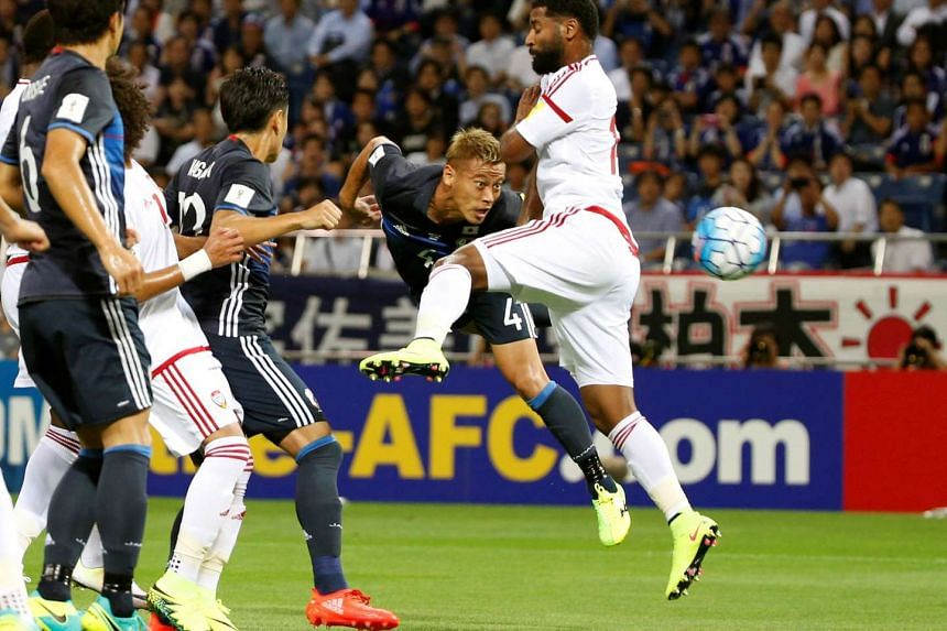 Japan's Keisuke Honda heads the ball to score a goal against the UAE during their World Cup 2018 qualifier match in Saitama, Japan on Sept 1, 2016.
