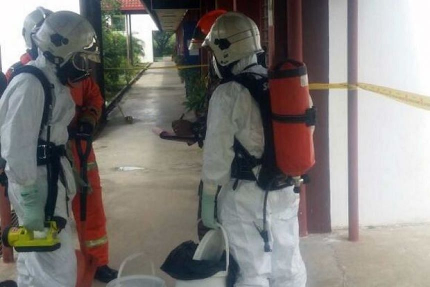 A Hazmat crew cleaning up a mercury spill in a classroom in a school in Labuan, Sabah.