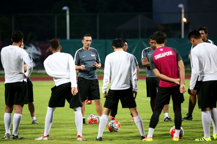 Singapore Under-21 coach Richard Tardy gives instructions to his team at a training session at Bishan Stadium on July 18, 2016.