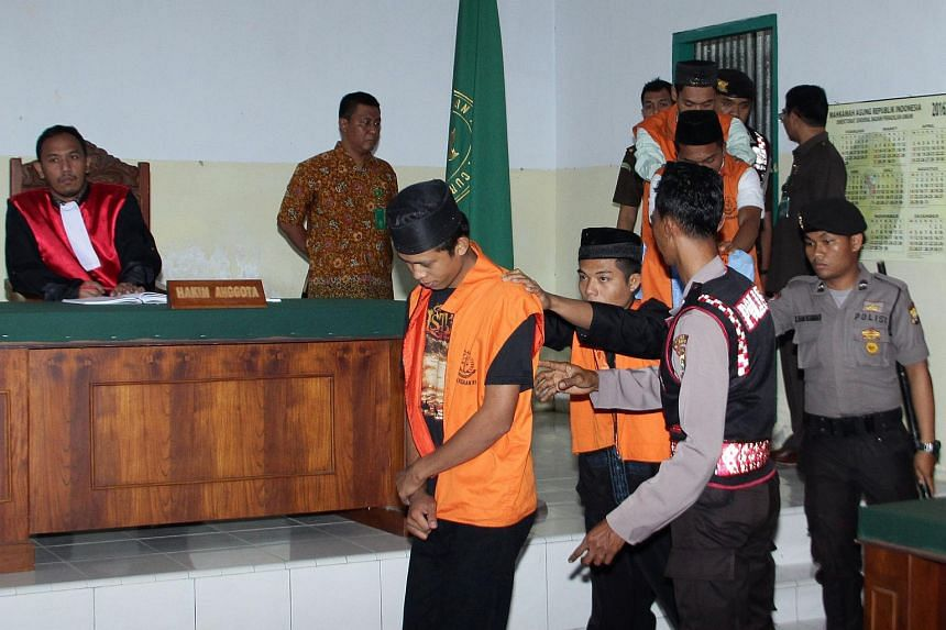 Indonesian suspects charged for the gang-rape and murder of a 14-year old schoolgirl are produced in court in Curup, Bengkulu province on Aug 4, 2016.
