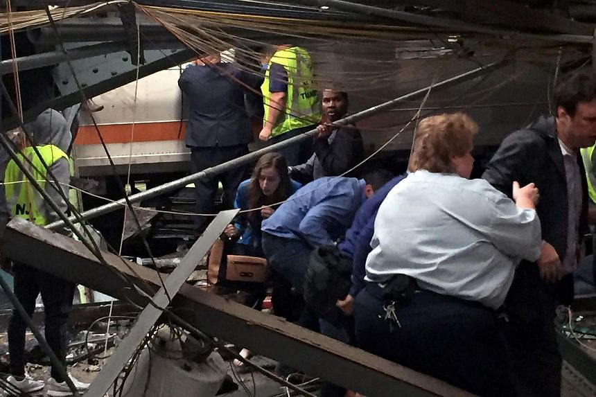 Passengers rush to safety after a NJ Transit train crashed in to the platform at the Hoboken Terminal on Sept 29, 2016 in Hoboken, New Jersey.