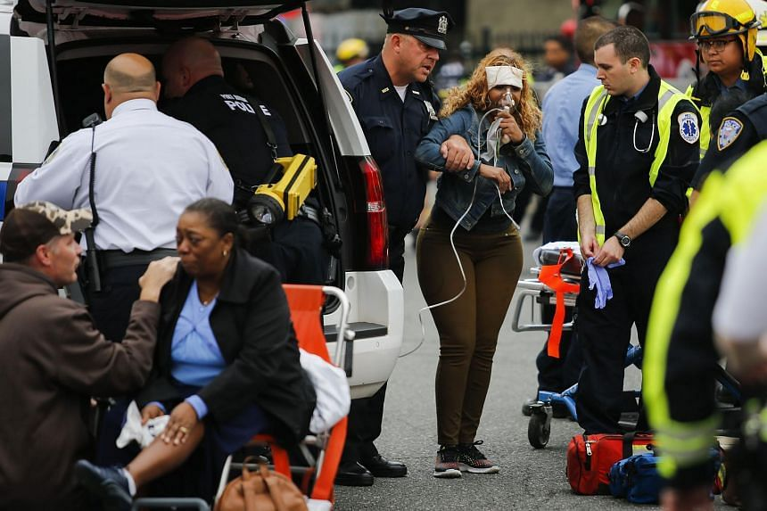 People are treated for their injuries outside after a NJ Transit train crashed in to the platform at Hoboken Terminal on Sept 29, 2016 in Hoboken, New Jersey.