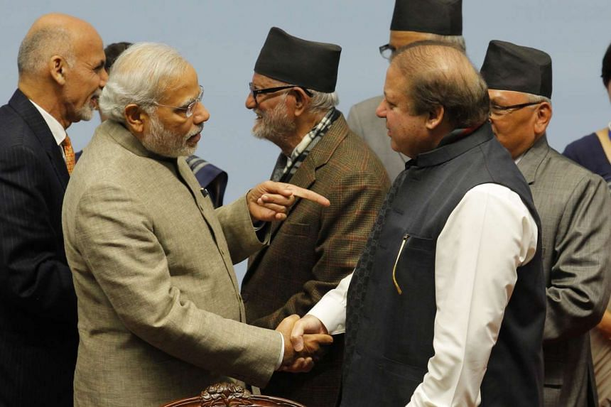 This file photo taken on November 27, 2014 shows Indian Prime Minister Narendra Modi (left) shaking hands with Pakistan's Prime Minister Nawaz Sharif during the closing session of the 18th SAARC summit at City Hall in Kathmandu.
