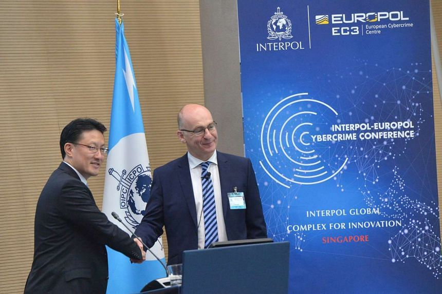 Interpol's executive director for the Global Complex for Innovation Noboru Nakatani and its European Cybercrime Centre Head Steven Wilson officially open the 4th Interpol-Europol Cybercrime Conference.
