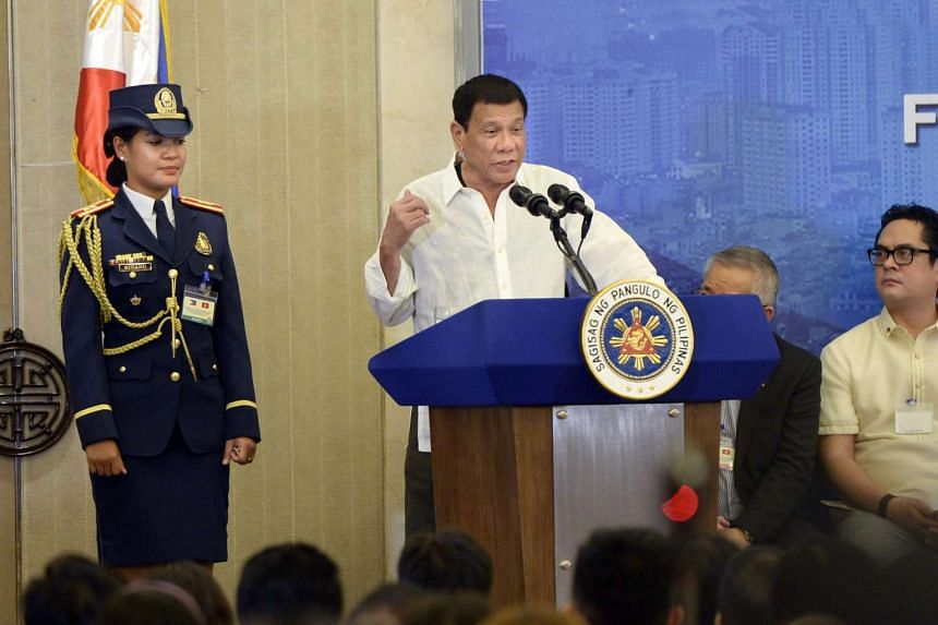 Philippines President Rodrigo Duterte speaks as he meets with the Filipino community in Hanoi, Vietnam on Sept 28, 2016.