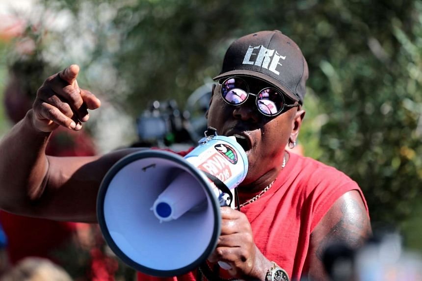 Amir Rahim leads protesters gathered at the El Cajon Police Department headquarters in chants to protest the fatal shooting of an unarmed black man on Tuesday by officers in El Cajon, California, US.