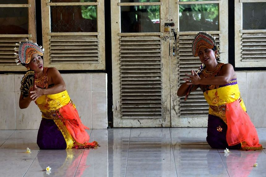 Deaf people performing a traditional dance at the Bengkala village in Bali.