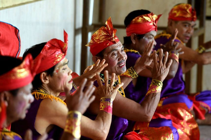 Deaf villagers performing a traditional dance at the Bengkala village in Bali.