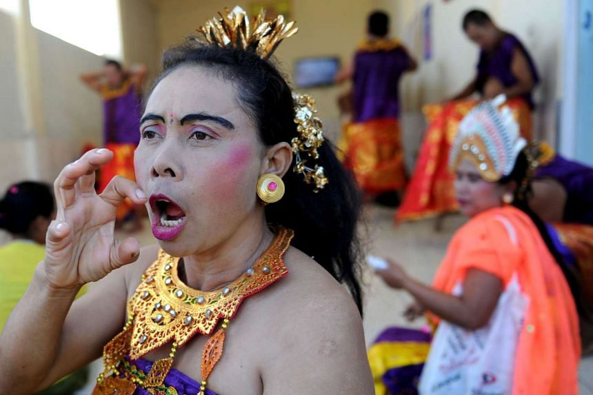 Deaf villagers preparing to perform a traditional dance at the Bengkala village in Bali.