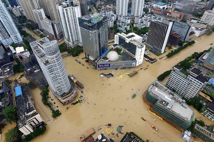 Floodwaters turned streets in Xiamen into rivers as Typhoon Megi swept through Fujian province yesterday.