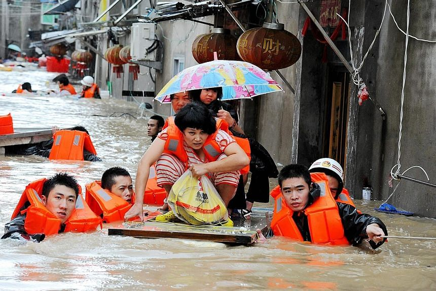 Rescuers evacuating residents in Ningde in eastern China's Fujian province yesterday. Typhoon Megi hit China with winds of around 120kmh.