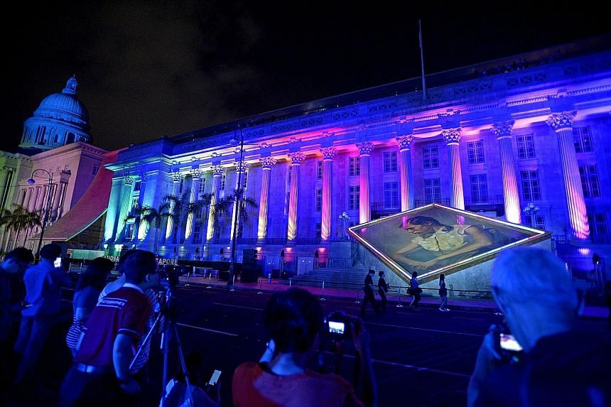 Images being projected onto the facade of the National Gallery Singapore during its grand opening on Nov 27 last year. The gallery saw tens of thousands of visitors in its first week.