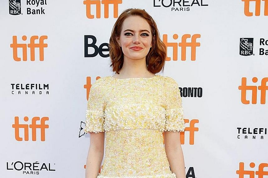 Actress Emma Stone (left) on the red carpet for the film, La La Land, at the Toronto International Film Festival in Canada earlier this month.