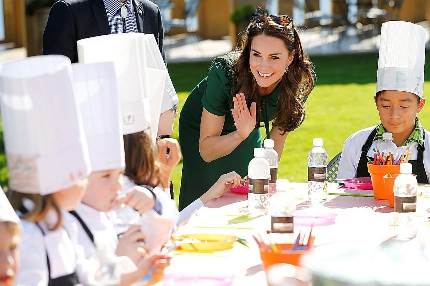 Britain's Duchess of Cambridge Kate Middleton mingling with some children during the Taste of British Columbia event at Mission Hill winery in Kelowna, British Columbia, Canada, on Tuesday. The Duke and Duchess of Cambridge are visiting Canada with t