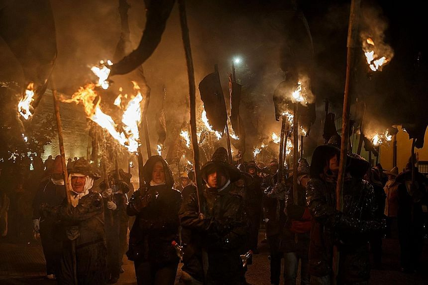 Locals using hanging wineskins in flames as torches as they took part in the Vitor's Civic Procession in Mayorga, Spain, on Tuesday. The procession marked the occasion on Sept 27, 1752 when the people of Mayorga emerged from their homes with torches