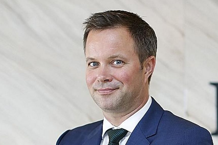 Note holders (left) filing an acceleration notice to trustee DB International Trust yesterday against Rickmers Trust Management, led by chief executive Soeren Andersen (above)