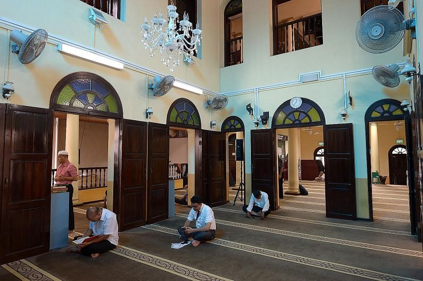A Chinese copy of the Quran in the mosque. Mr Arif, the mosque's secretary, said the place of worship is open to all - even tourists and other visitors who are not Muslims. Motorbikes parked before noon prayers. While the mosque serves mostly Indian