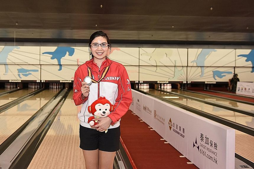 National kegler Jasmine Yeong-Nathan (left) with her bronze from the women's Masters event at the Asian Bowling Championships in Hong Kong. She lost to eventual champion Jung Da Wun of South Korea in the step-ladder semi-final 224-177.