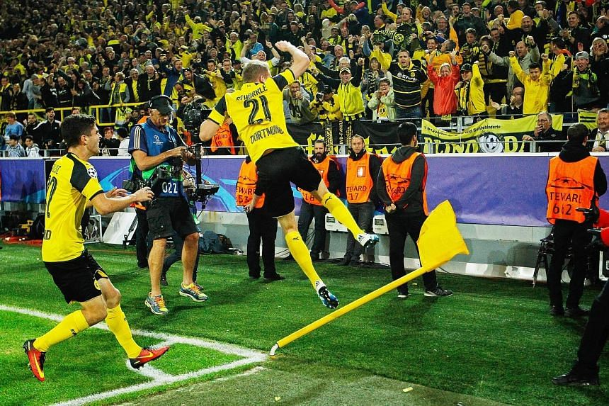 Andre Schurrle showing his joy after netting the late equaliser that helped Borussia Dortmund draw 2-2 with Real Madrid.