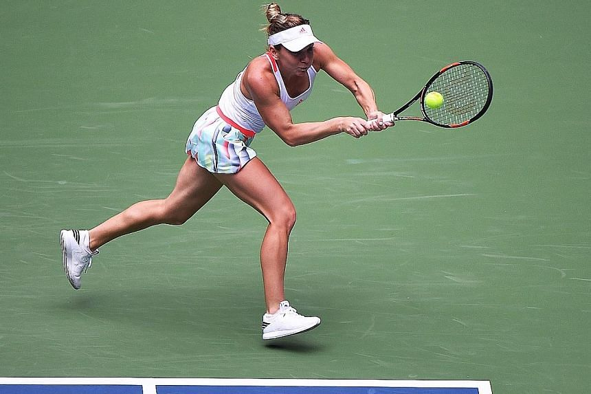 Romanian Simona Halep hits a backhand against Yaroslava Shvedova in the Wuhan Open round of 16. She won in straight sets to set up a clash wtih American Madison Keys and a chance to qualify for the WTA Finals Singapore.