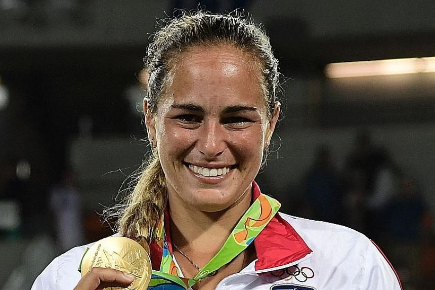 World No. 27 Monica Puig admits that it has been difficult adjusting to her new status as Olympic champion.