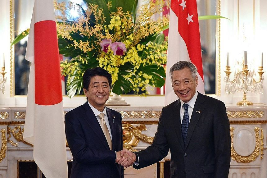 Prime Minister Lee Hsien Loong meeting his Japanese counterpart Shinzo Abe at the state guest house in Tokyo yesterday. Their bilateral meeting was the leaders' ninth since 2013.