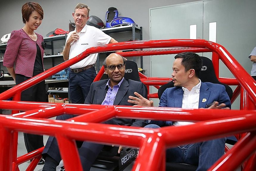 Mr Tharman sitting in a Dendrobium hypercar space frame built by the research and development arm of Wong Fong Industries. With him are Wong Fong Industries executive director Eric Lew (right) and Parliamentary Secretary Low Yen Ling.
