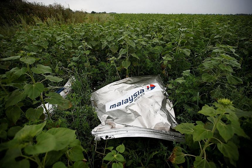 Left: Members of an international team presenting the preliminary results of a criminal investigation into the downing of Malaysia Airlines Flight MH17, in the Netherlands, yesterday. A reconstruction of the missile strike that is believed to have le