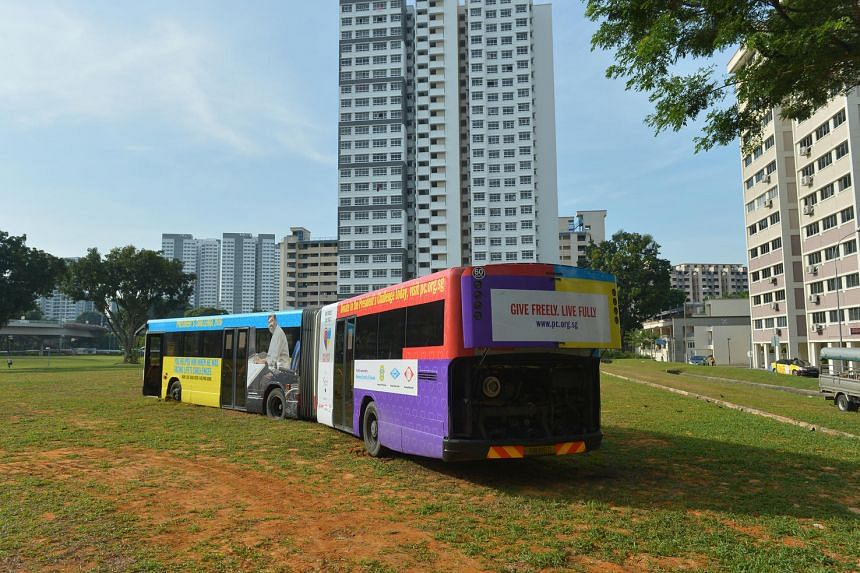 The SMRT bendy bus has been stuck on a field behind Block 195, Kim Keat Avenue since midnight.