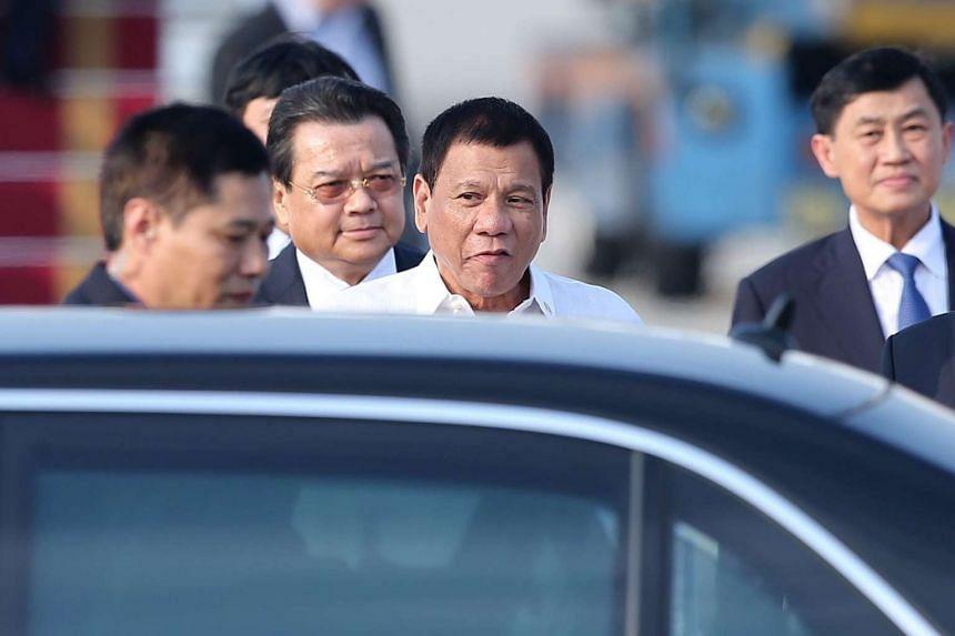 Duterte (centre) arrives at Noi Bai international airport in Hanoi, Vietnam, Sept 28, 2016.