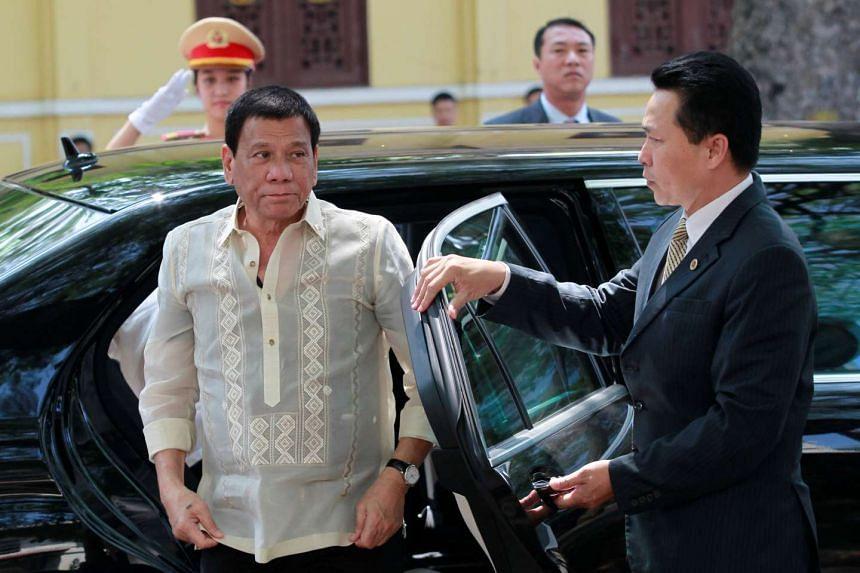 Philippines President Rodrigo Duterte (left) arrives at a restaurant for lunch in Hanoi, Vietnam, Sept 29, 2016.
