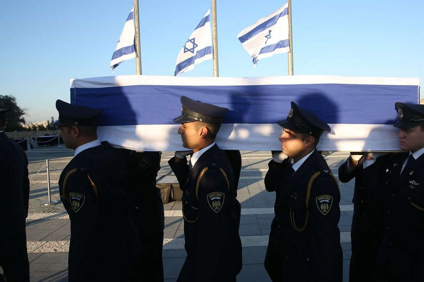 Members of the Israeli Knesset guard carrying the coffin of former Israeli president Shimon Peres at the Knesset, Israel's Parliament, in Jerusalem on Sept 29, 2016.