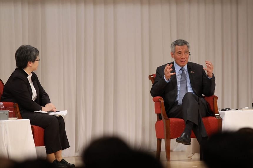 PM Lee Hsien Loong speaking at the special session of the 22nd Nikkei International Conference on Sept 29, 2016. With him on stage is moderator Sonoko Watanabe.