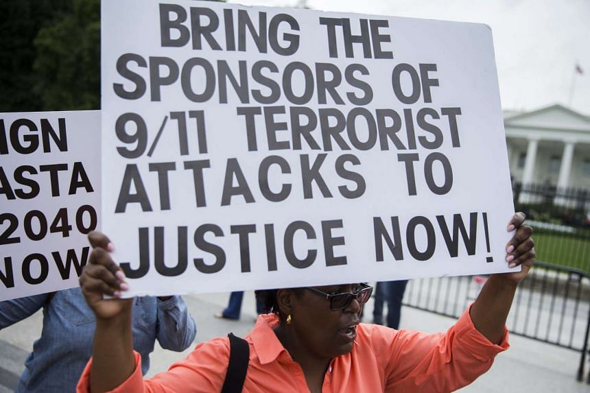 Protesters participating in a rally against US President Barack Obama's plan to veto the Justice Against Sponsors of Terrorism Act (JASTA), in front of the White House in Washington, DC, on Sept 20, 2016.