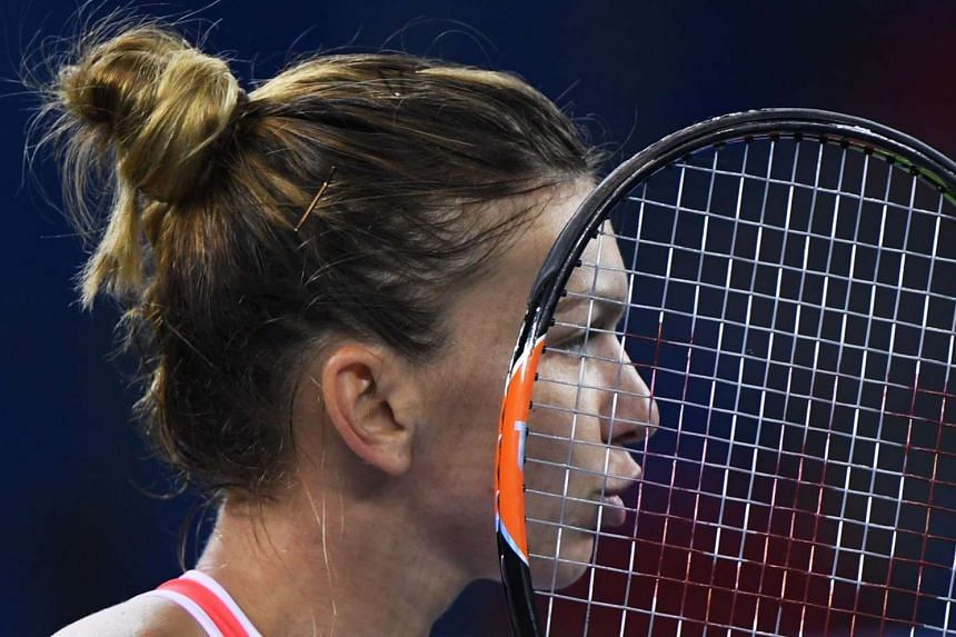 Simona Halep of Romania reacts during her quarter-final match against Madison Keys of the US.