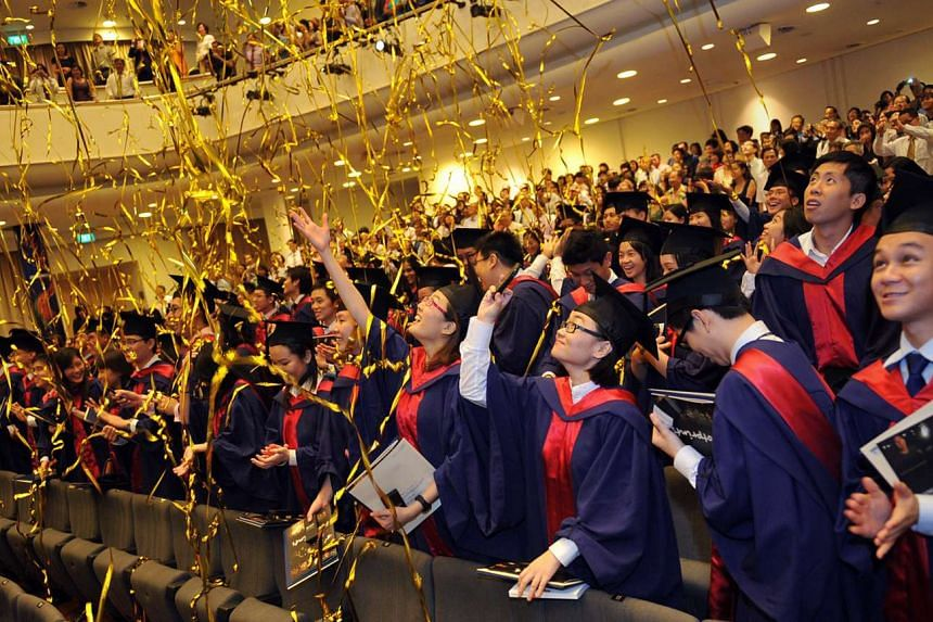 NUS graduates at a graduation ceremony. NUS made the top 10 in two of the eight academic subjects ranked in the latest Times Higher Education world university tables.