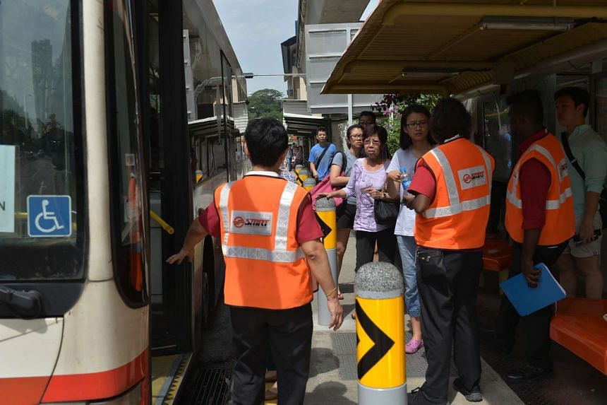 Commuters boarding a shuttle bus at Bukit Panjang station.There was some confusion over which buses to board and where the bus would stop.