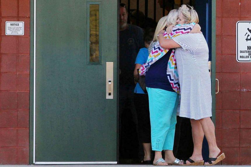 Two teachers hug outside Townville Elementary School on Sept 28, 2016.