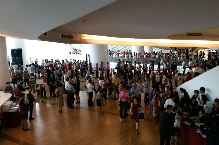 People in the queue to attend SMRT's shareholders' meeting at the Star Theatre.